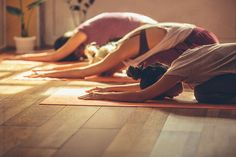 Three women in a yoga class.