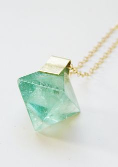 Featuring a beautiful pyramid shaped Green Fluorite Stone which was hand framed into a 14k gold filled pendant.  This necklace highlights the