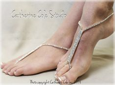Add a little glamour to your beach wedding wearing our sparkly silver rhinestone barefoot sandals. Glamorous is the perfect word to describe these chic modern silver rhinestone foot jewels! Our rhines