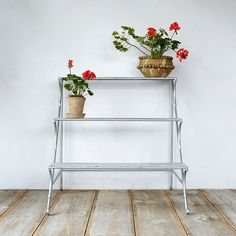 """Hand-crafted from durable wrought iron with a galvanized finish, this sleek trio of shelves is the perfect place to display an indoor garden.  - Wrought iron, hot dip galvanized finish - Rinse with garden hose to remove any loose dirt or wipe clean with damp cloth - Indoor or outdoor use - Imported  36""""H, 36""""W, 38.5""""D"""
