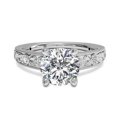 This vintage-inspired engagement ring features an engraved band with sparkling pave diamond details.