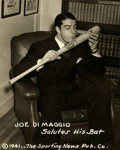 Joe DiMaggio salutes his bat. Date Created/Published: December 15, 1941