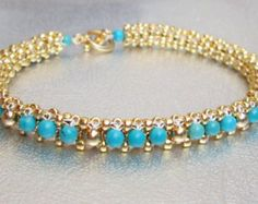 A beautifu bead wrap bracelet of jet picasso tila and gold and pale green super duo beads. This is a unique and trendy bracelet. It will go with a nice dress or a t shirt and jeans. Stack it with other bracelets or wear it alone. It will fit over the average wrist twice. Gold toggle clasp. Treat yourself