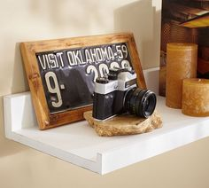 Okay...I know this is a link to shelving from pottery barn, but I LOVE the idea of a framed antique license plate!