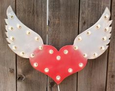Hey, I found this really awesome Etsy listing at https://www.etsy.com/listing/182720724/hearts-with-wings-vintage-lighted