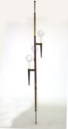 """Elegant but I'm wondering if those are the original """"globes"""" on this tension pole lamp."""