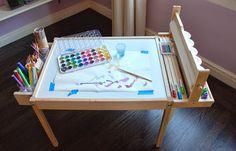 Design Ingenuity: DIY Kids Craft Table. Latt hack with paper roll holder mounted along side instead of underneath.