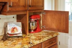 I like the idea of putting the mixer on the counter like this.  Good ideas when we redo our kitchen.