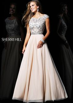 I really like the general shape of this dress, the cap sleeves, and the flowy skirt. Not a huge fan of all the beading, though.