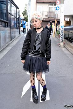 Marimo is a friendly Japanese model who we often see around Harajuku. Her look includes a black top, bomber jacket, and tulle skirt all from the brand #EMODA along with Spinns ( #スピンズ ) platform boots and an o-ring choker. #tokyofashion #street snap #Harajuku