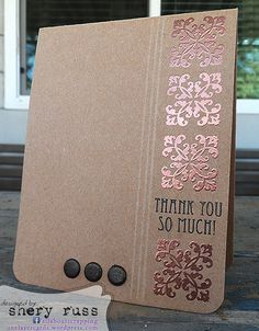 Love the copper embossing powder on the stamped medallions.  Chocolate brown brads and simple embossed lines are all you need on this classy handmade thank you card.