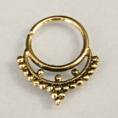 Septum Ring - Septum Jewelry - Septum Piercing - Septum Cuff - Indian Nose Ring - Indian Septum Ring - For Pierced Nose  This gorgeous traditional septum is made of oxidized brass and decorated with small brass balls.   For pierced nose. Can be worn on the ear as well.  Nickel Free. $13.5