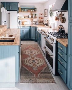 This Is How You Rock Blue Cabinets in the Kitchen cozy blue kitchen w. This Is How You Rock Blue Cabinets in the Kitchen cozy blue kitchen with butcher block countertops ideas Modern Farmhouse Kitchens, Farmhouse Kitchen Decor, Home Kitchens, Galley Kitchens, Vintage Kitchen Decor, Farmhouse Style, Country Kitchen, Modern Kitchen Decor, Bohemian Kitchen Decor