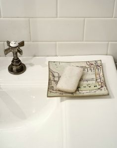 interesting soap dish, the cross handle tap + white subway tile-- simple