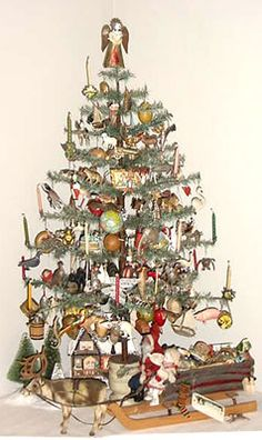 """tall antique feather tree decorated with German """"Dresden"""" ornaments. The tree has built-in candle holders and has an early round wooden base. The ornaments are all embossed cardboard dating 1870 thru Antique Christmas Ornaments, Old Fashioned Christmas, Christmas Past, Victorian Christmas, Primitive Christmas, Christmas Tree Decorations, Christmas Holidays, German Christmas, Wood Ornaments"""