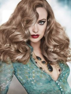 Old Hollywood glam reinvented. Love the shirt and the necklace. The hair color is very old hollywood. You don't see these types of 80's sponge curls anymore.