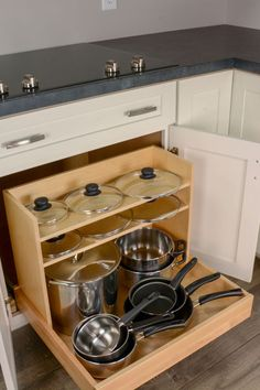The pots & pans organizer is a factory-installed base cabinet insert designed to help you conveniently store your cookware right beneath your cooktop. Kitchen Room Design, Kitchen Cabinet Design, Kitchen Redo, Home Decor Kitchen, Kitchen Furniture, Kitchen Interior, Home Kitchens, Kitchen Remodel, Kitchen Base Cabinets