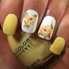 yellow nails with floral accents....soooo cute for spring or summer<3