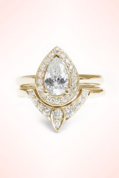 http://rubies.work/0015-rings/ Pear Shaped Diamond Engagement Ring with Matching Side Diamond Band - The 3rd Eye