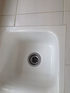 Tile flush with sink for more updated look and easy cleaning