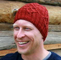 This men's hat features a diamond-shaped cable pattern with straighter lines rather than the more curved lines usually found in cables, perfect for the man who needs a little extra warmth, whether or not he is slaying a dragon. The brim can be worn down or folded up to suit the size and style desired. The pattern contains both charted and fully written out instructions.