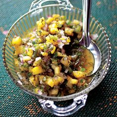 Salsa de Piña (Fresh Pineapple Salsa)  Tropical fruit adds sweetness and acidity to this fragrant, spicy salsa. The tart pineapple is a perfect foil for rich meats, stewed chicken, and roasted fish.