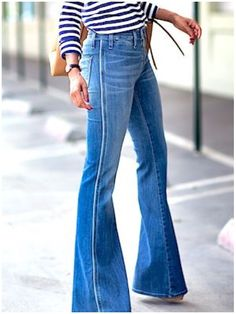 Obsessed with these bell bottom flare jeans! Perfect to cinch that waist and make your legs look super long. WANT!