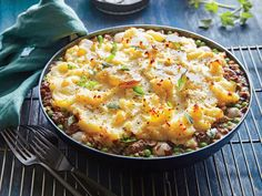 Shepherd's pie is an outstanding use for leftover mashed potatoes. The addition of mushrooms, what a forager might find, makes for a delicious twist on the classic. This one-skillet supper also makes cleanup a breeze. If transporting or freezing the dish, place the beef mixture in a 9-inch square baking dish coated with cooking spray before adding the potatoes. We love meaty shiitake mushrooms here; cremini mushrooms would also work. Let the mashed potatoes, peas, and pearl onions thaw at…