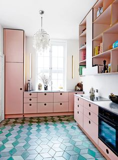 Turquoise floor in a pink kitchen