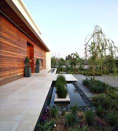 הרמוניה ושילוב פנים וחוץ בעיצוב בית במרכז הארץ | עיצוב בתים פרטיים | עיצוב פנים ואדריכלות | מגזין בית ונוי |