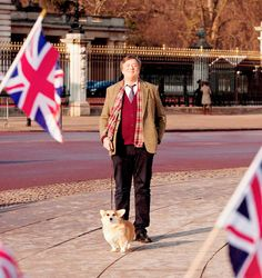 "Stephen Fry walking a #Corgi outside Buckingham palace. Filed under: ""Most Wonderful Thing I've Seen Today"""