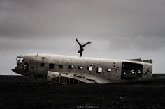 Girl on the DC-3 - American girl on the  DC-3 plane wreck on the plains of Solheimasandur in Iceland