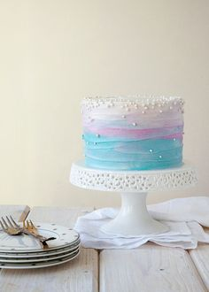 A blueberry and lavender wedding cake with ombre frosting is a fantastic choice for a modern wedding.
