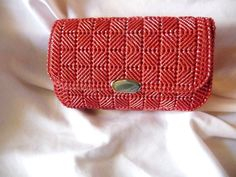 1960s clutch in raspberry pink/red with metallic silver threads  Brand: Hand made Dimensions: approx 7 wide x 4 1/2 high Fabric: Threaded plastic canvas Features: Matching cotton fabric lining, silver snap closure Condition: Good, some minor wear on the inside  You will get the exact item shown in the pictures. Condition issues are as listed, all sales are final. Feel free to contact me if you have any questions. We do ship internationally, message us for a quote.
