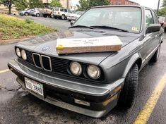 Even on rainy days, picking up #carparts for the #e30 is fun! Any guesses on what's in the box?? #bmw #frontendfriday