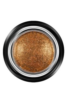 From It's Elemental: Makeup's New Molten Movement Giorgio Armani Beauty Eyes To Kill Intense Silk Eyeshadow in Gold Blitz, $33