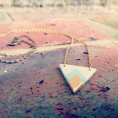 Handmade polymer clay chevron triangle necklace decorated with acrylic paint and metal leaf Polymer Clay Necklace, Polymer Clay Pendant, Polymer Clay Charms, Clay Earrings, Hoop Earrings, Polymer Clay Projects, Polymer Clay Creations, Handmade Polymer Clay, Colar Diy