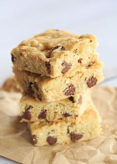 Drunk Blondies - A cakey blondie with bourbon, pecans, coconut and chocolate chips!   https://www.browneyedbaker.com/drunk-blondies/ #recipe #easter #tradition #classic #spring #gather #family
