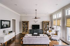 1757 Upland Lakes. Another angle of the huge living room with lots of natural light, high ceilings, crown molding and custom fan. Bernstein Realty, Houston Real Estate.