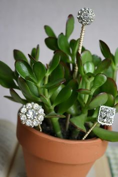 I try to keep my uber-girliness in check (mostly) when it comes to fashion and home decor, but these little plant stakes are the perfect way to sneak in a little sparkle.  Great use for old costume clip on earrings, maybe?