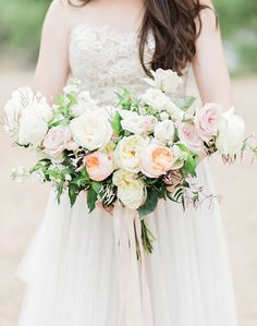 Romantic bridal bouquet of blush cream garden roses