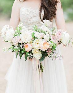 Romantic bridal bouquet of blush cream garden roses