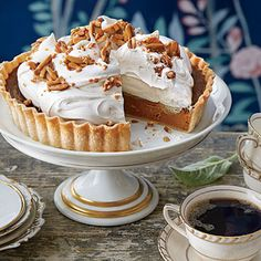 Pumpkin Tart with Whipped Cream and Almond Toffee | Molasses and pumpkin pie spice give this elegant take on pumpkin pie its deep autumnal flavor.