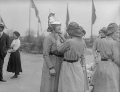 1916, Preparing for a fire drill. | 25 Stunning Vintage Photographs Of Female Firefighters