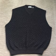 FIERTE MEN'S 70's Vintage sweater vest Size S FIERTE s.r.l. Men's 70's Vintage black & brown v-neck baggy sweater vest. 60% Acrylic 25% Wool 25% Alpaca in a light weight fabric. Made in Italy, hand washable in great condition like new ! Fierte s.r.l. Sweaters V-Necks