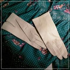 Vintage Ecru Leather Driving Gloves Super soft genuine leather driving gloves.  They're an ecru/beige color - a little bit lighter than the pictures.  They've never been worn, size S.  Very sweet! Accessories Gloves & Mittens