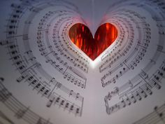 Red Heart and Music Sheets. - A beautiful quilled heart would make a nice design!