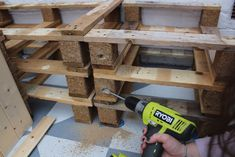 How to build pallet seating with built-in storage hidden storage. This DIY is quick, easy and super cheap! Check out the full tutorial here to build yours! Pallet Seating, Pallet Bench, Flat Ideas, Uk Homes, Built In Storage, Home Renovation, Wine Rack, Outdoor Storage, Garden Ideas