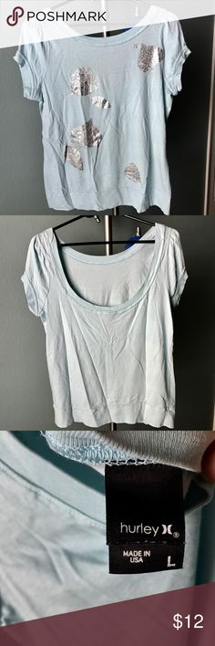 Hurley Super Soft Cotton Tee Light Blue & Silver L Super soft cotton Hurley tee with low scoop back. Large but in juniors sizing. Soft baby blue and mint color with artistic silver leaf motif. Low back (see images) and 100% cotton. Never worn, but washed once. NTOW. Hurley Tops Tees - Short Sleeve