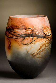 June Ridgeway  The work is coil built, burnished and saggar fired. Inspiration is from a number of sources: erosion or weathering, just as the patina of age takes its course over any surface subjected to the elements, so the smoke and the added ingredients placed in the saggar, such as salt, wire, oxides, make their unique marks directly on the satin, burnished surface of the piece.